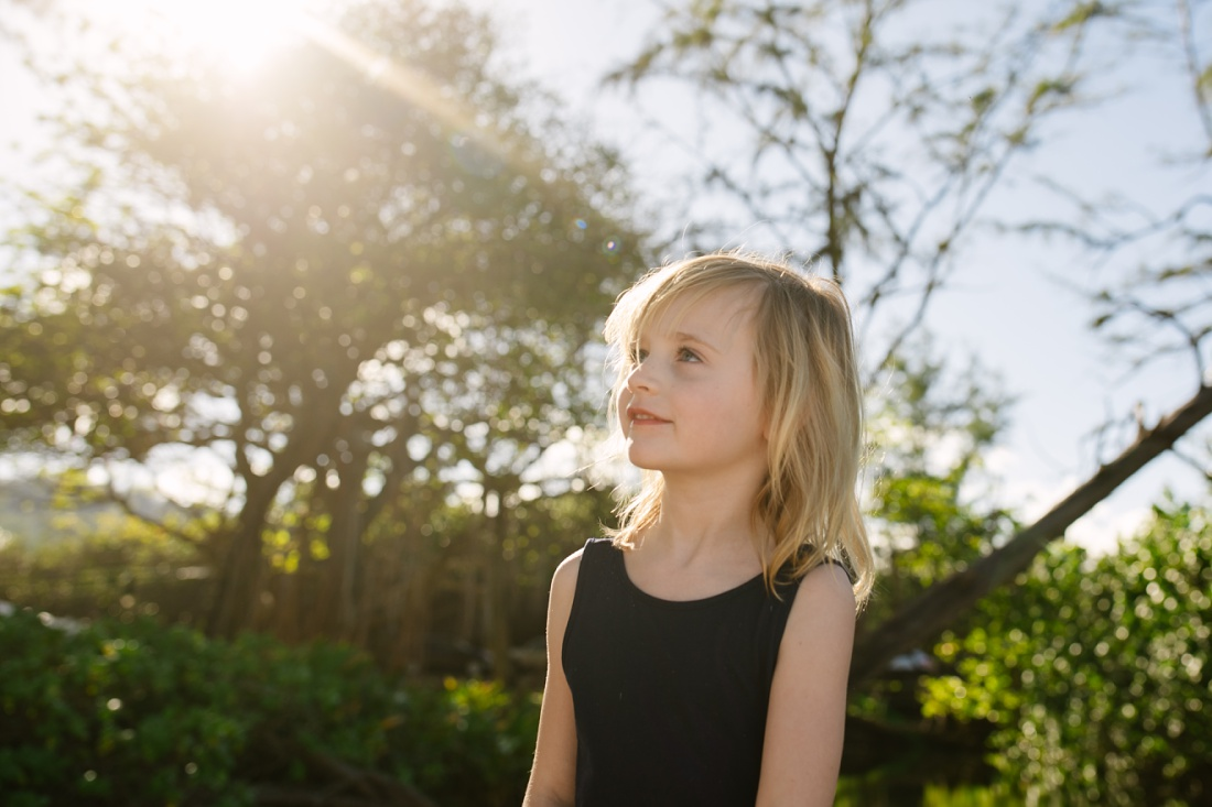 portrait of a girl in hawaii with sunflare