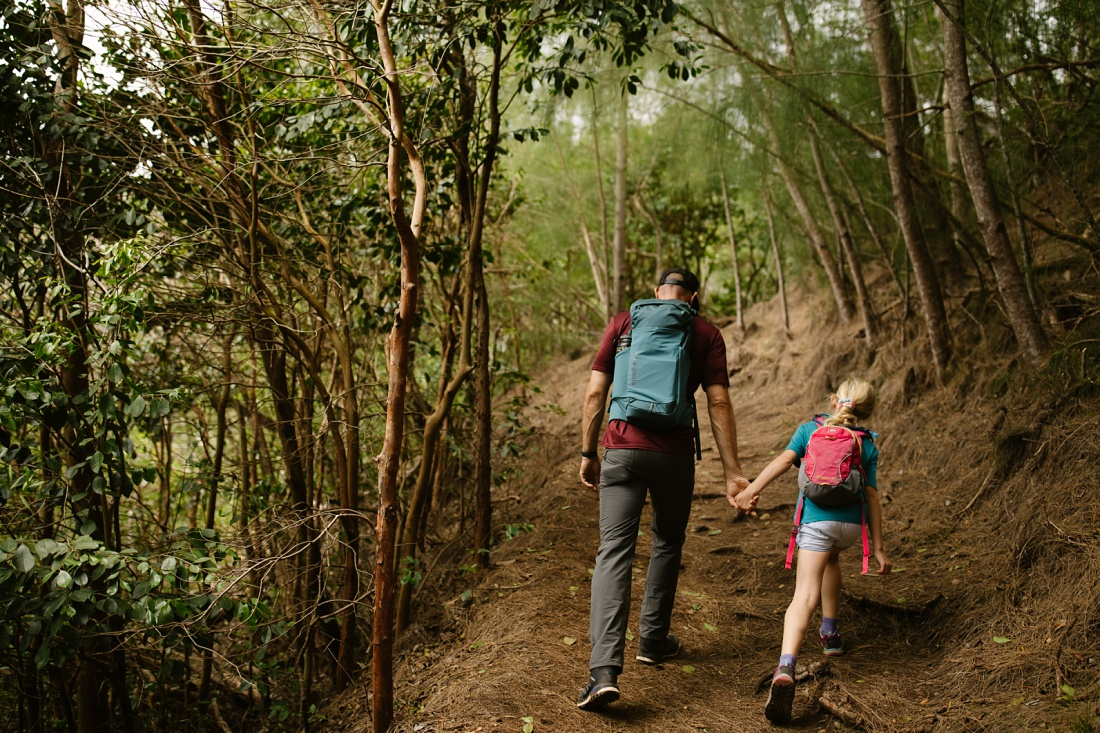 dad and daughter holding hands on a farmily-friendly hike on oahu