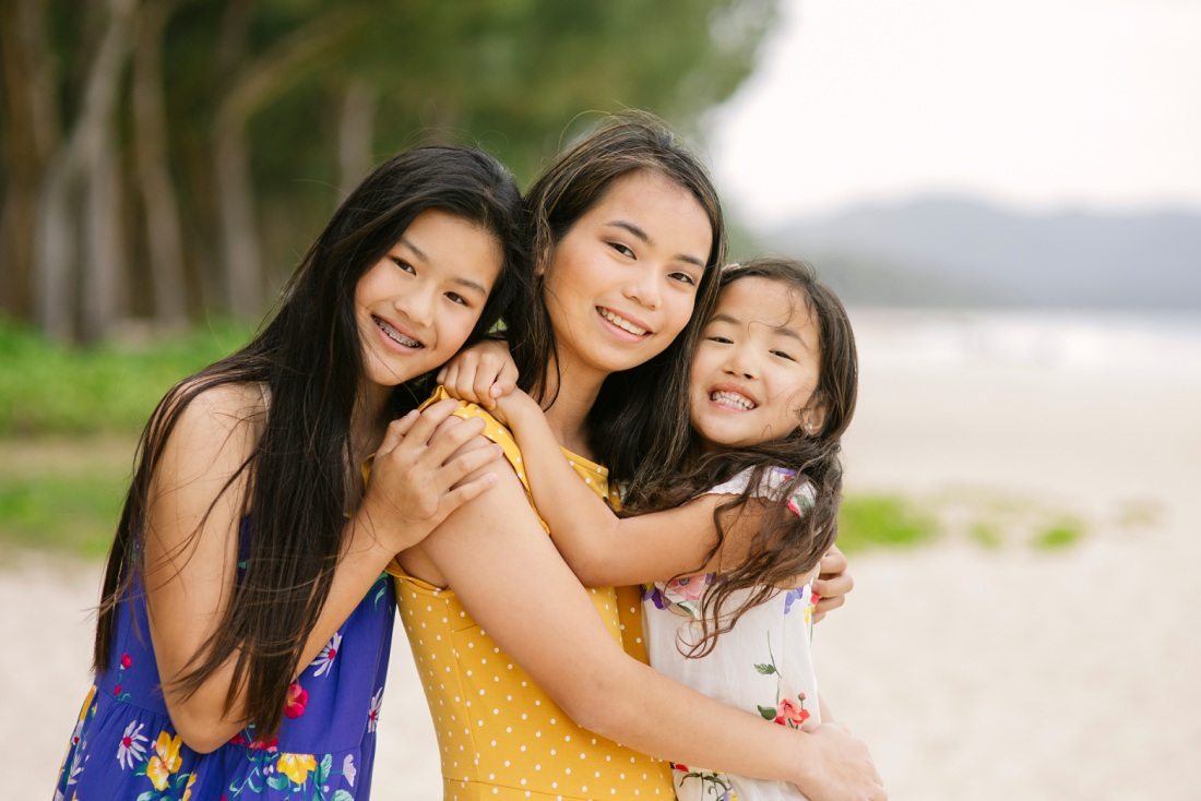 sisters sharing a hug during a family photo session
