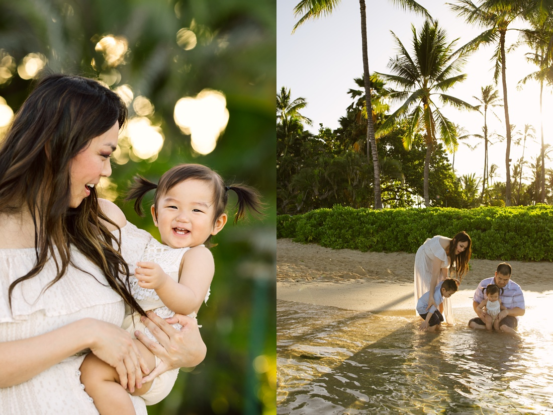 family playing on the beach in hawaii during a family photo session