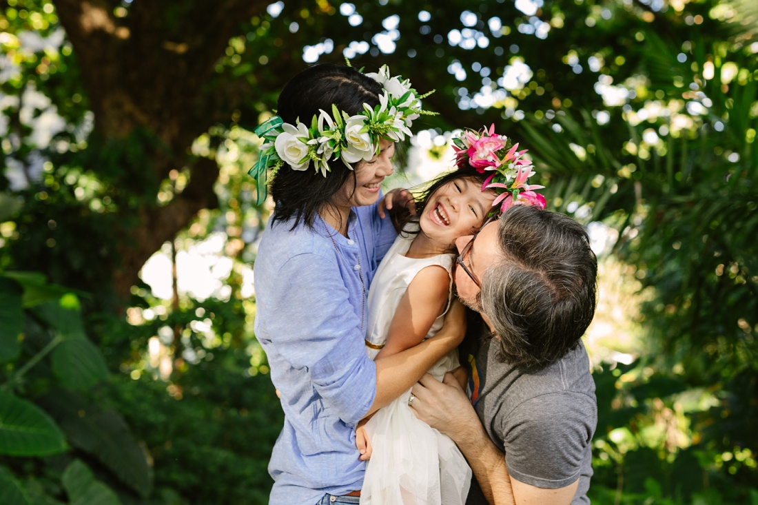 a family shares a big hug during a session by a family videographer hawaii