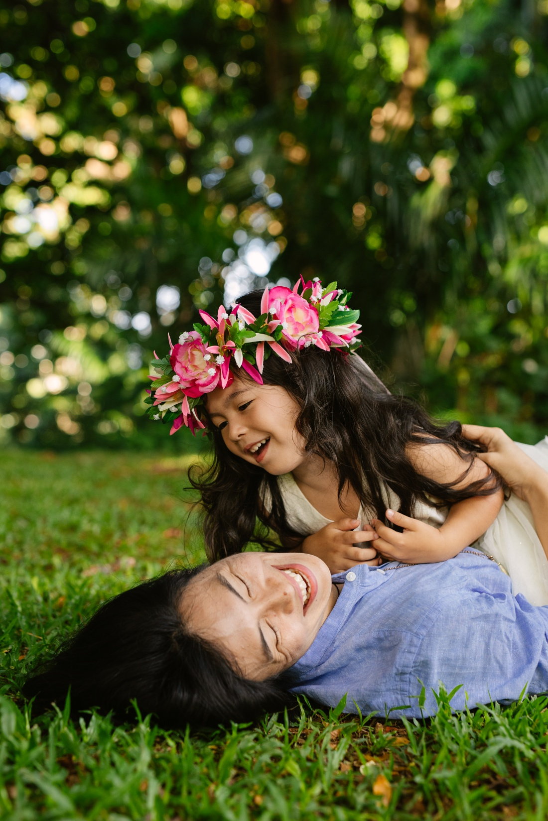 mom and daughter laughing during a family photo session by little bird photography