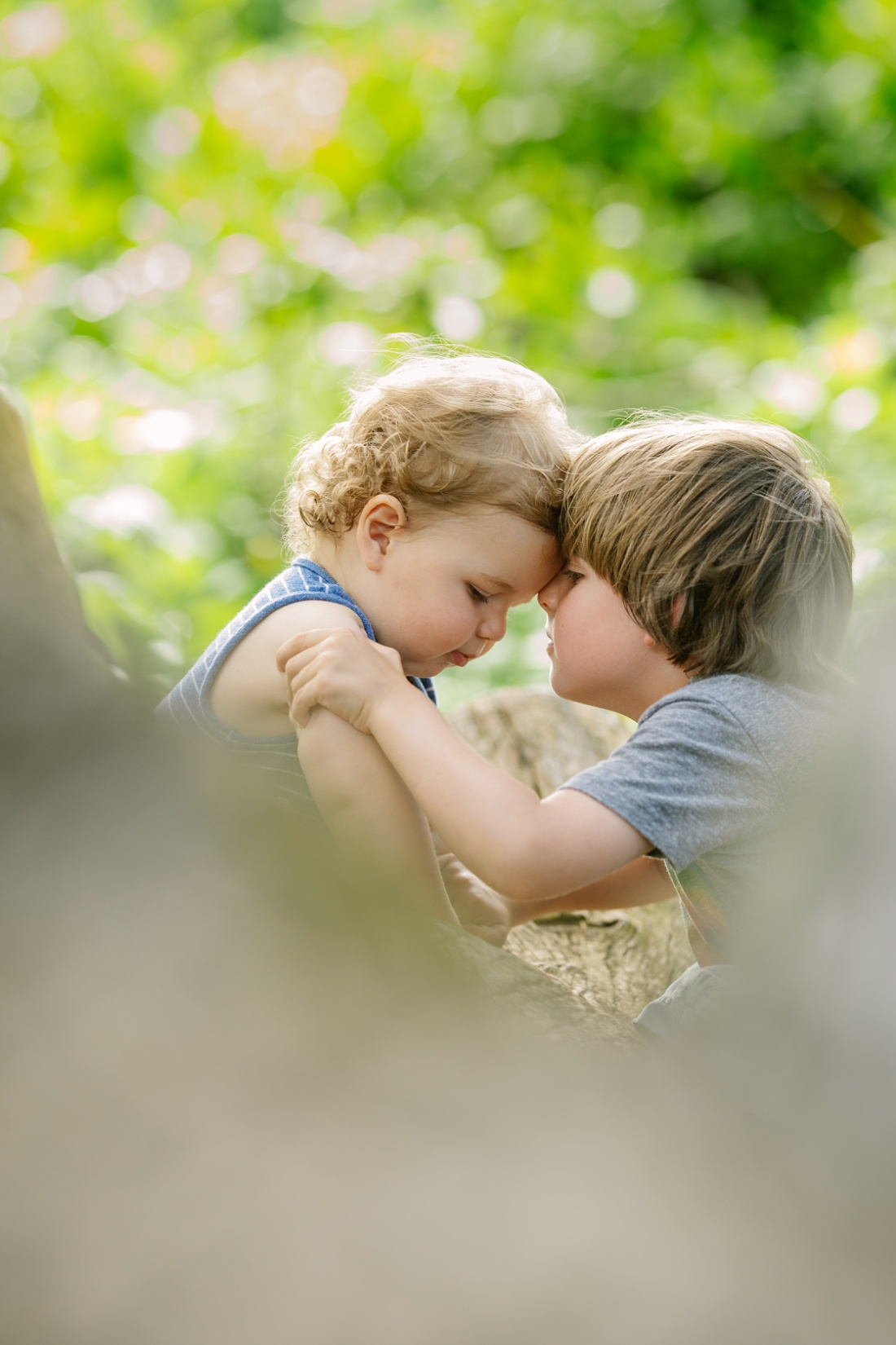 siblings snuggle during a family photo session in hawaii by little bird photography