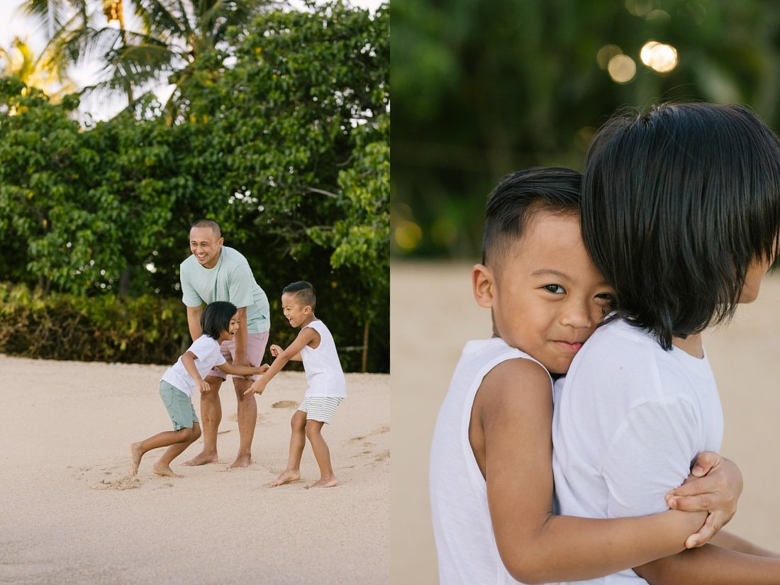 brothers playing on the beach at paradise cove koolina for family photos
