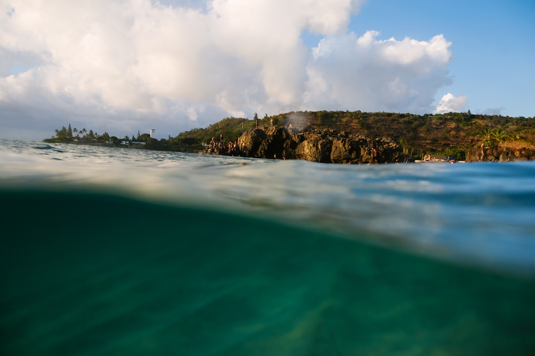 view of waimea bay jumping rock from the water