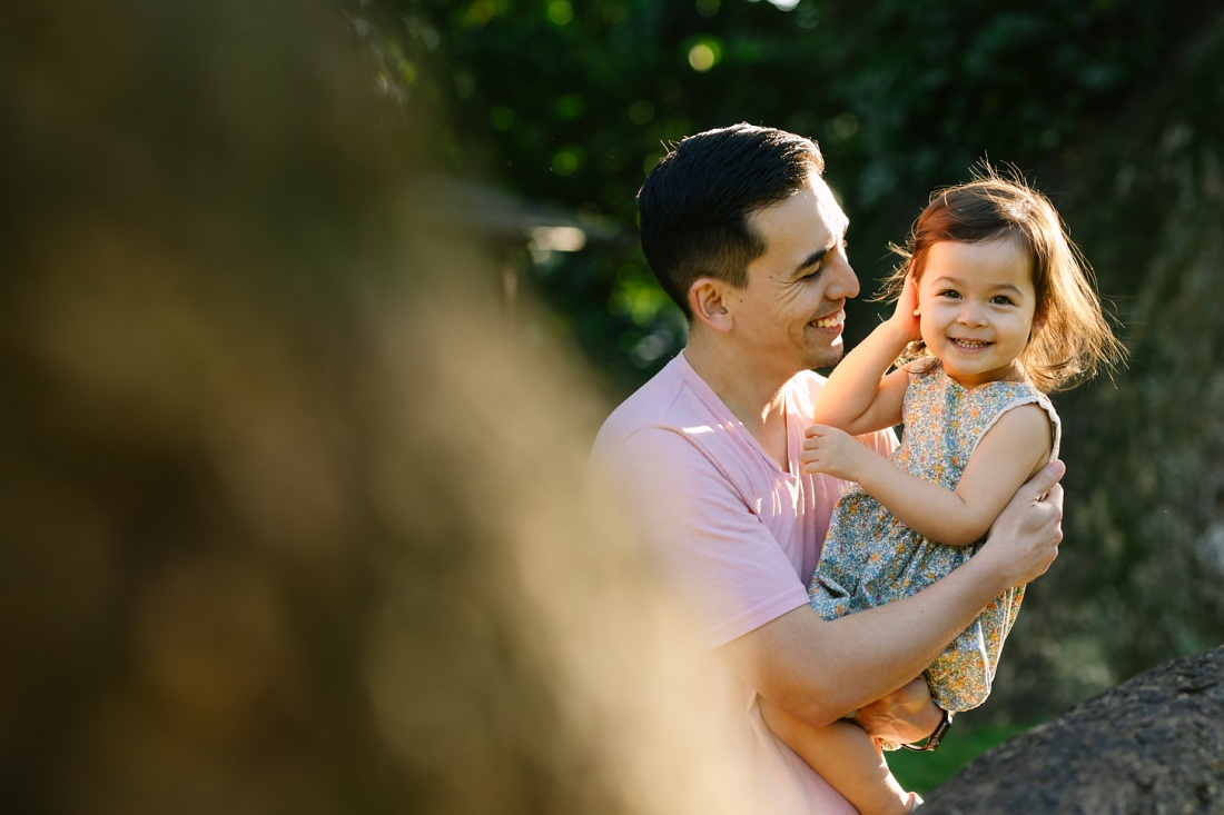 dad and toddler daughter playing during a family photo session in hawaii