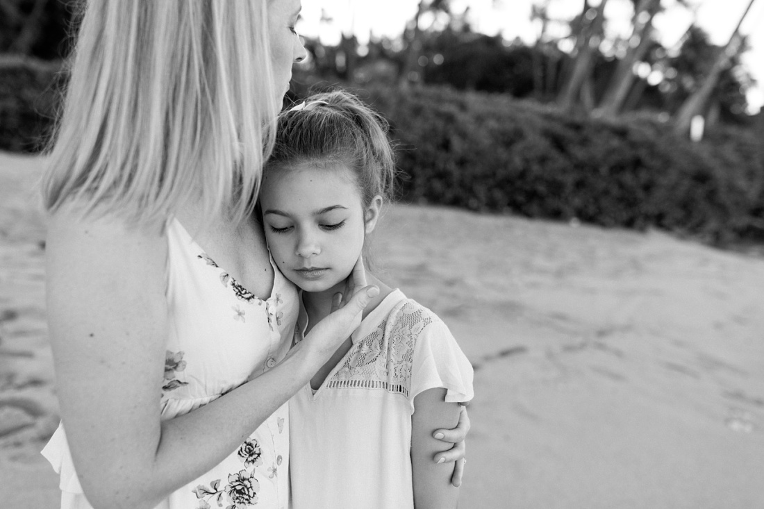 mom snuggles daughter in black and white during a family photo session