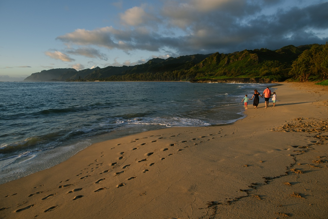 family walking at laie beach at sunrise