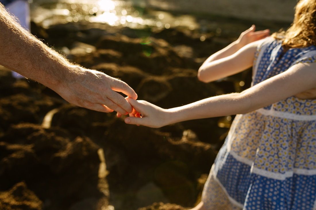 dad and daughter holding hands