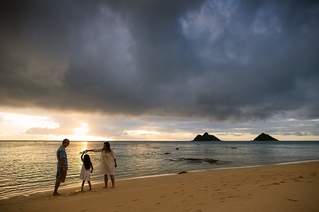 family portrait during a moody sunrise over lanikai beach