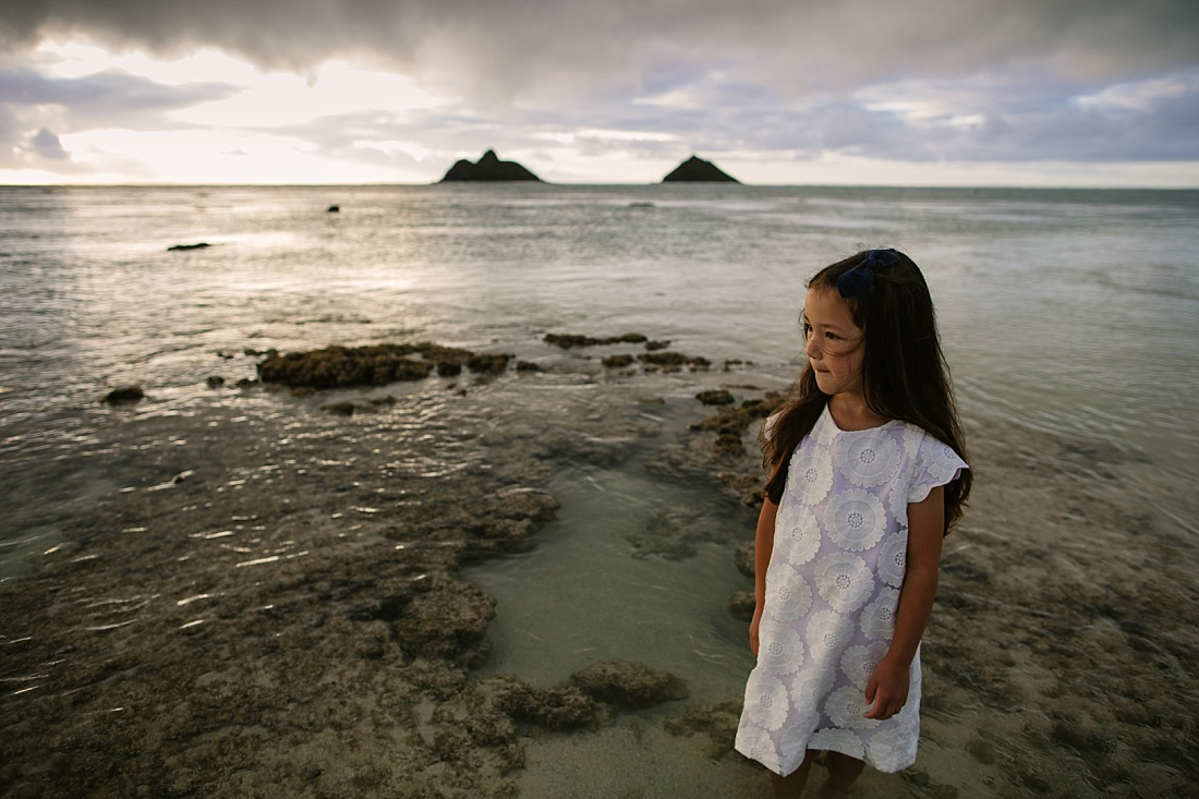 portrait of a girl with the mokuluas behind by lanikai family photographer little bird photography