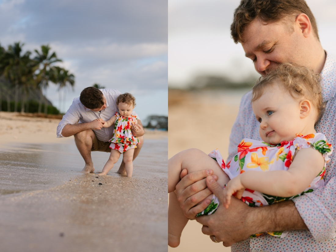 dad and baby daughter play on the beach at kualoa at sunrise