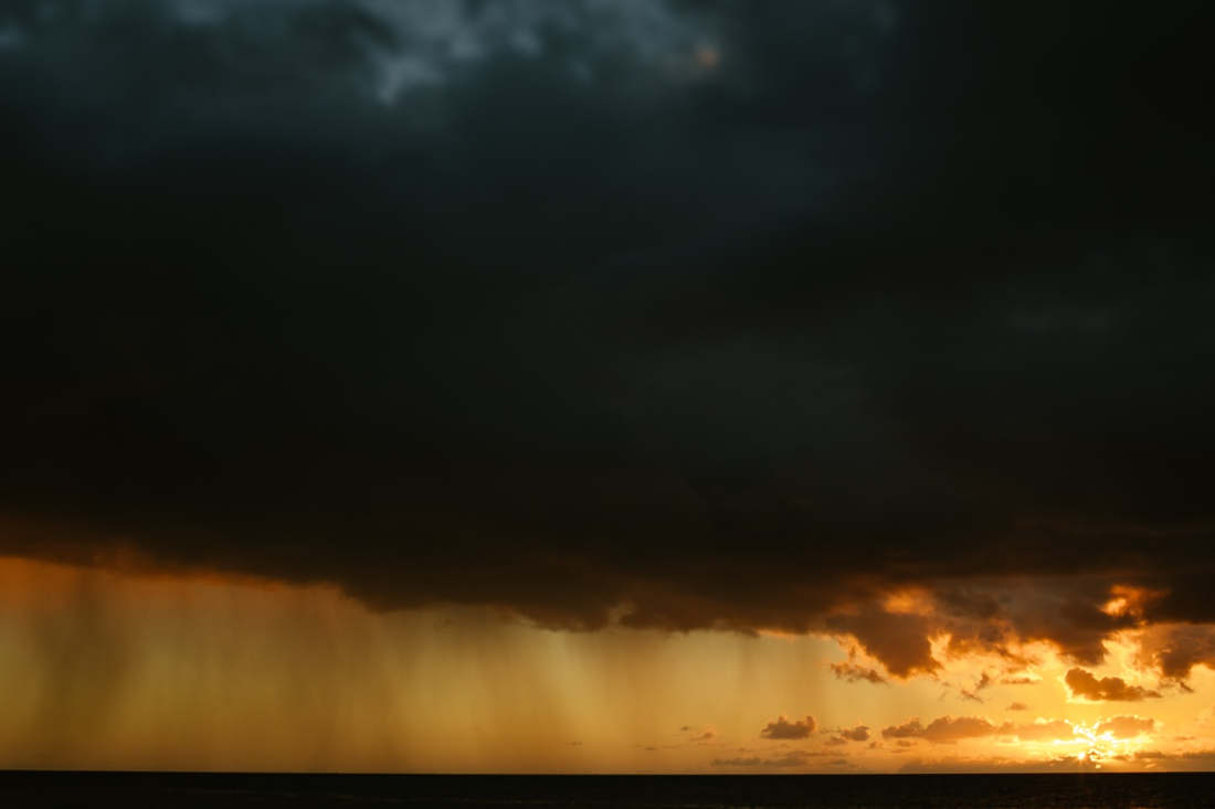 storm clouds at sunset in hawaii