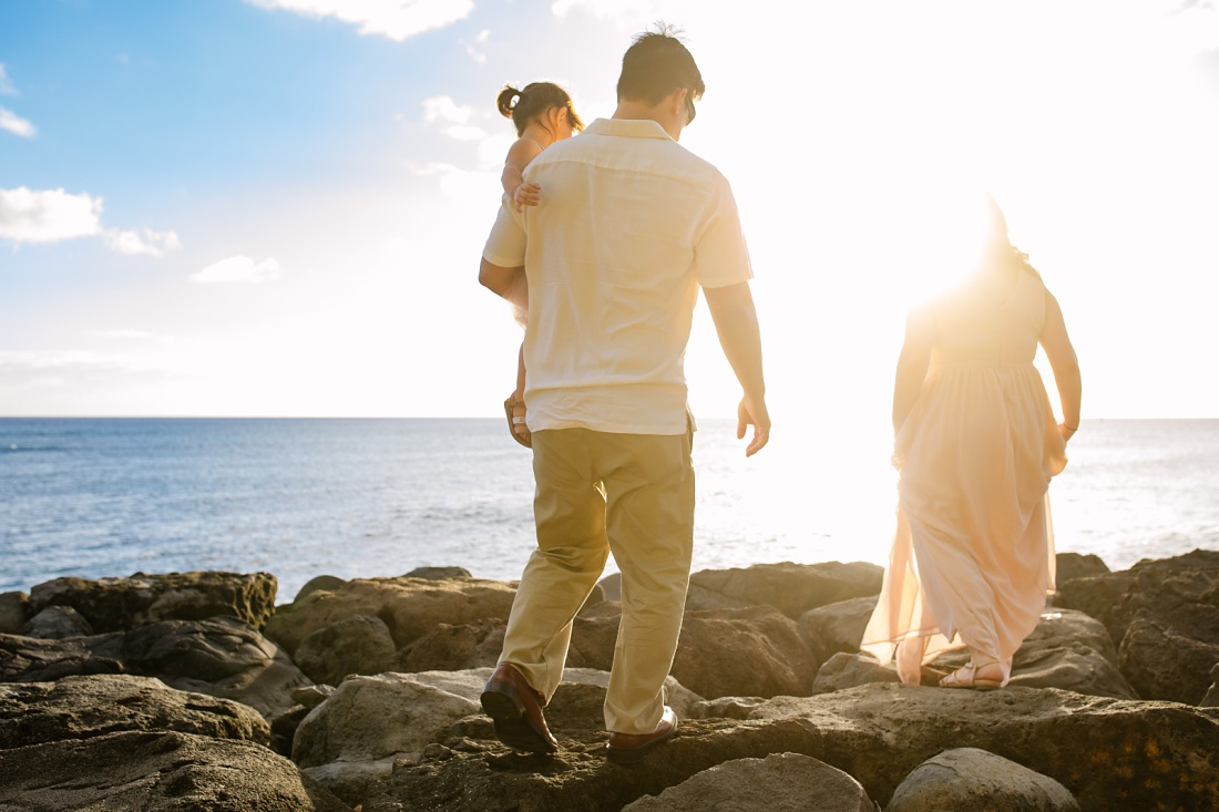 family waling on the shore at kakaako park in honolulu