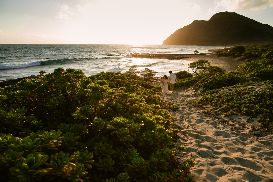 family portrait in a dramatic landscape at makapuu beach in oahu hawaii by little bird photography