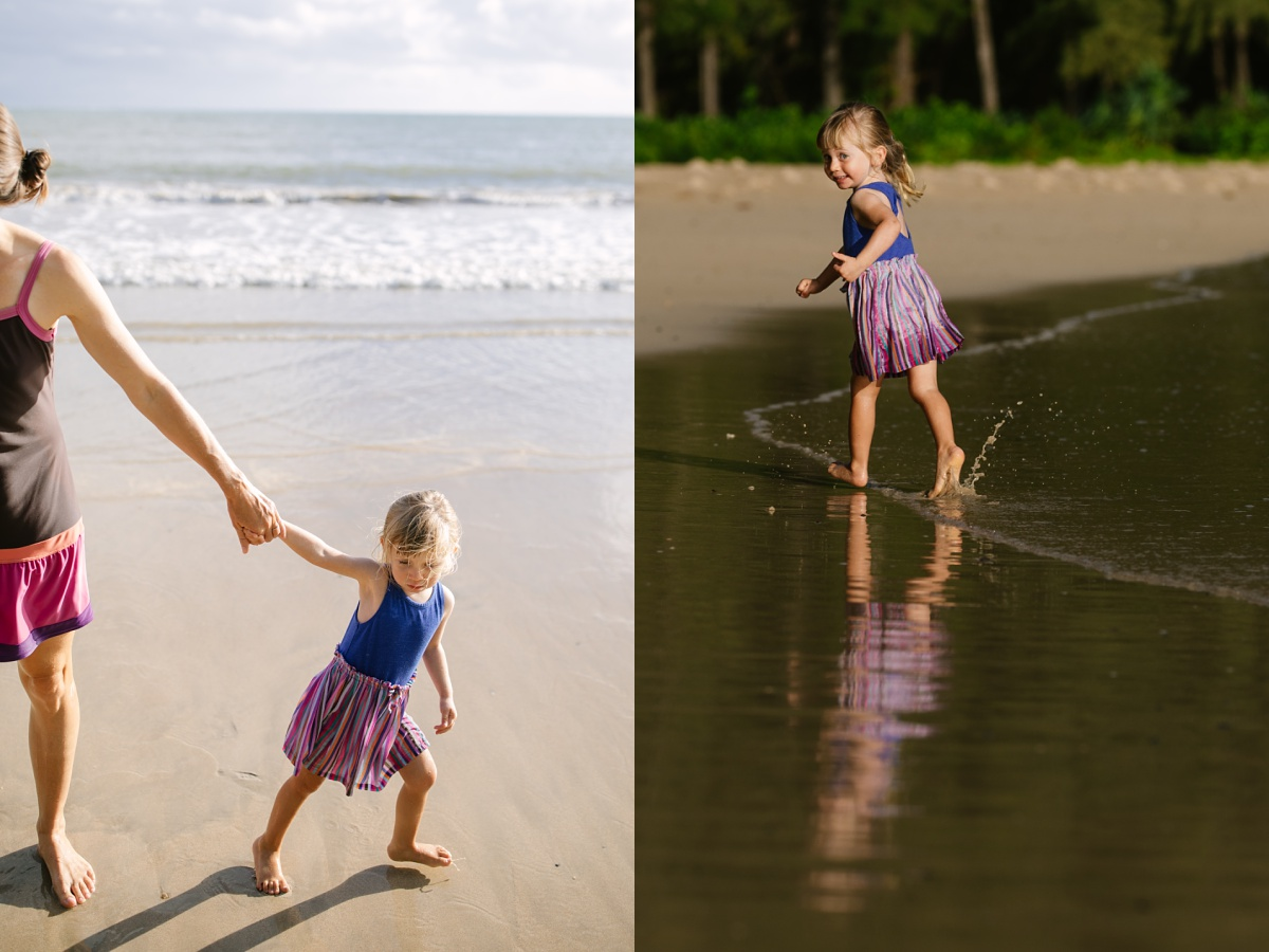 toddler playing on the beach in hawaii during a family photography session