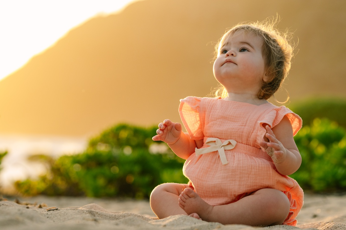 portrait of a chubby-cheeked baby at sunrise in hawaii