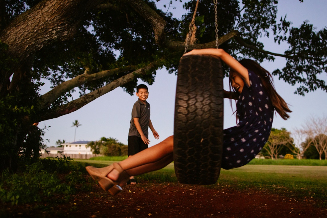 kids play on a tire swing at kaha park in kailua