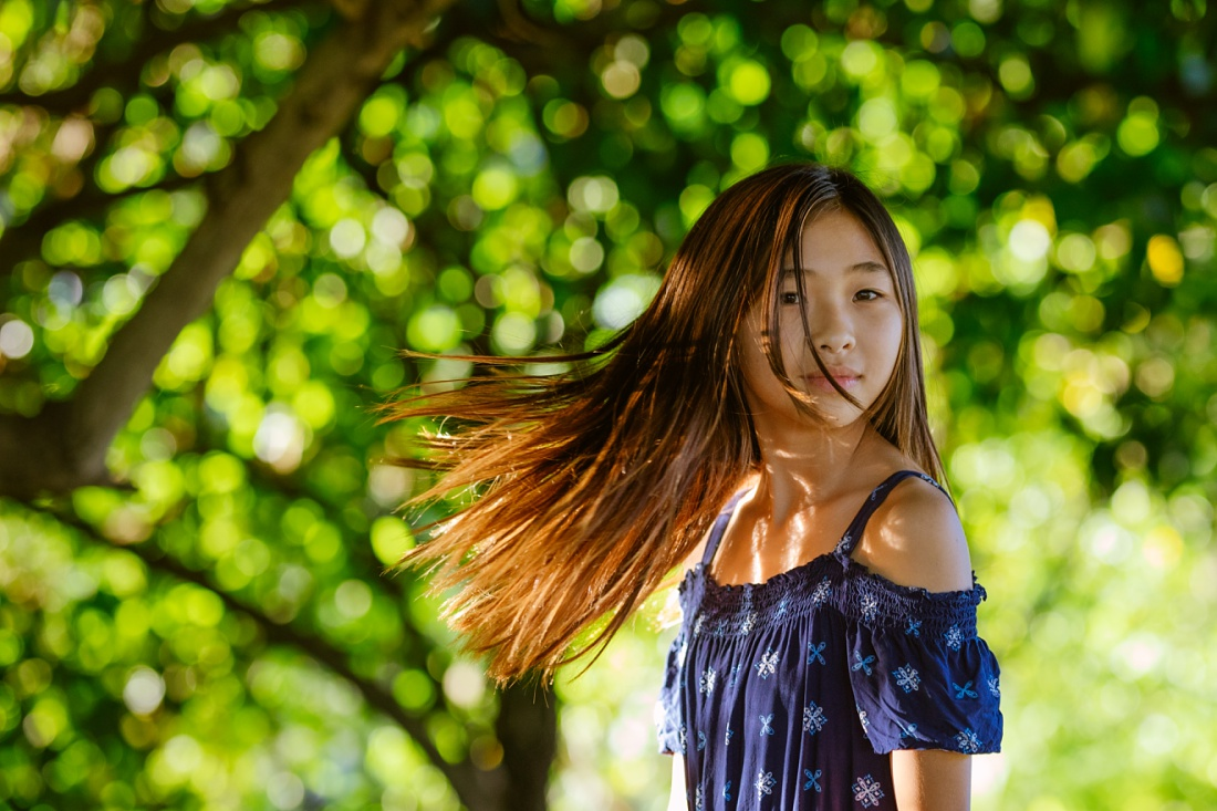 portrait of a girl swinging her hair during oahu child portraits session