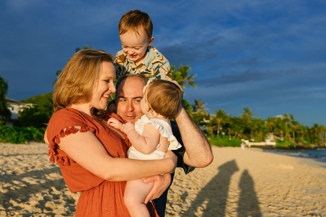 big messy family hug during a lanikai family portrait session