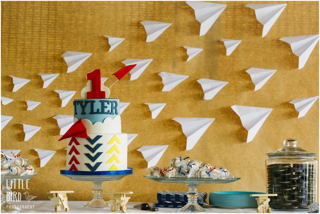 tyler's first birthday party- the cake behind airplane setting at teahouse in oahu
