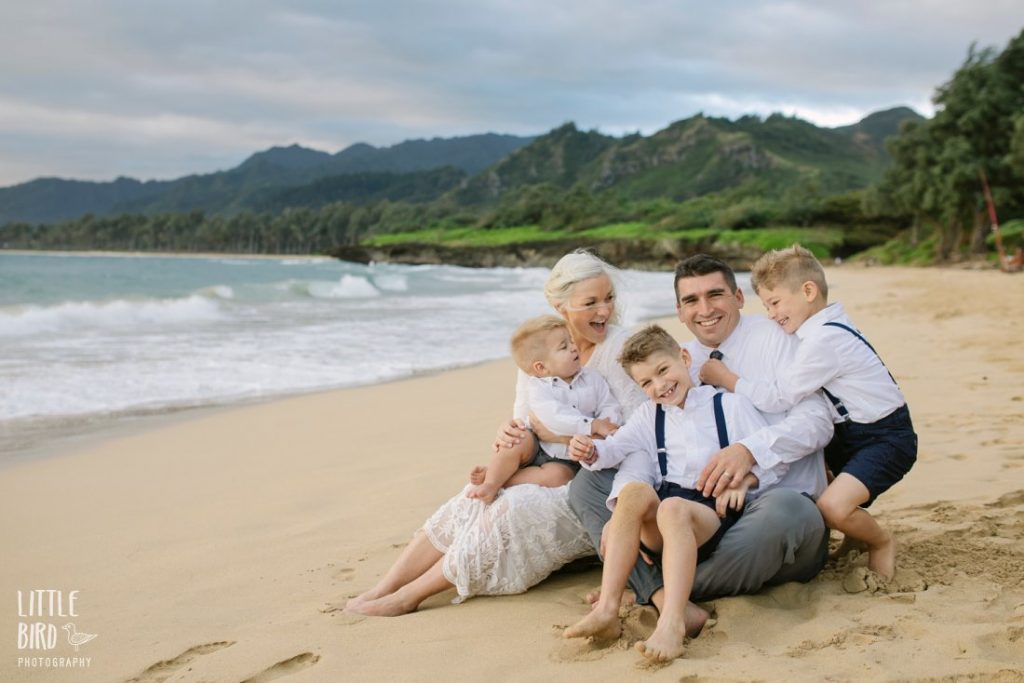 family cuddles during hawaii photo shoot